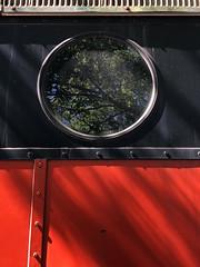A Window on the Past (Diorama Sky) Tags: railroad us gm texas unitedstates diesel tx rail nh transportation newhaven locomotive grapevine matter generalmotors emd diesellocomotive fl9 herbertmatter electromotivedivision newyorknewhavenhartford mcginnis grapevinevintagerailroad patrickmcginnis nh2014 gvrx2014 red color reflection window glass round fora dioramasky black midcenturymodern