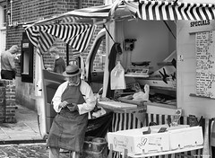 Fishmonger (akatsoulis) Tags: uk nikon streetphotography oxford oxfordshire wallingford wallingfordmarket blackandwhite fishmonger