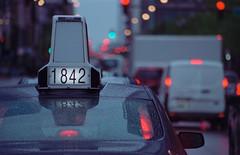 Taxi Bokeh (Jovan Jimenez) Tags: canon eos rebel t2 ef 75300mm f456 iii fujifilm superia venus 800 colour neg 35mm film cinematic bokeh 300x kiss7 analogue taxi cab street fujicolor fuji rain raindrops numbers