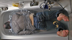 bathroom (marcostetter) Tags: wetlook wet wetclothes wetclothing fullyclothed jeans blue water bathtub wetshirt barefoot feet