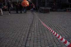 (kaliak) Tags: pentaxk5ll people tape umbrella orange red white cobblestones grandplace brussels