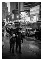 FILM - Carrying lunch through Times Square in the rain (fishyfish_arcade) Tags: 35mm analogphotography bw blackwhite blackandwhite canonsureshotz135 filmphotography filmisnotdead hp5 istillshootfilm monochrome analogcamera compact film ilford mono timessquare rain streetphotography