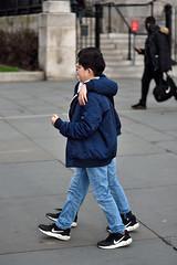 Two as one (jeremyhughes) Tags: london street trafalgarsquare boys kids children friends friendship two pair twins identical doppelganger candid nikon d750 nike