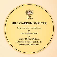Hill Garden Shelter. This shelter was built by Lord Leverhulme as part of the Hill Garden and Pergola development (1905 - 25). It was used in conjunction with a tennis court which was located where the pond, built by the London County Council in 1963, now (nick.harrisonfli) Tags: london plaque garden gardens flower flowers shrub shrubs shrubbery trellis pergola hampsteadpergola hampstead hill house gradeiilisted gradeii listed building terrace pergolas hillside stonework timbers climbingplants flowering plants plant climber climbers leaf leaves roses column columns lattice slope formal cityoflondoncorporation glc londoncountycouncil leverhulme baroninverforth baron inverforth pavilion thomasmawson landscapearchitect williamhlever lordleverhulme hidden gardening pool oasis england unitedkingdom openplaques:id=12137