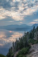 Crater Lake sunrise (Oleg S .) Tags: usa sunrise nature reflection mountains sky craterlake lake water oregon