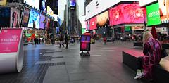 Girl In the Pink Raincoat (Anthony Mark Images) Tags: timessquare bigapple nyc newyork manhattan lights advertisements girlsitting pinkraincoat blondehair prettygirl photographer earlymorning people nikon d850 flickrclickx pink raincoat usa
