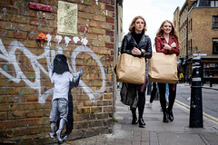All Saints (Silver Machine) Tags: london bricklane streetphotography street candid candideyecontact graffiti girls walking allsaints shopping brownpaperbag blonde fujifilm fujifilmxt10 fujinonxf35mmf2rwr leatherjacket