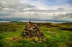Scroggy Bank Cairn (Brian Travelling) Tags: sky green grass clouds outside outdoors scotland pentax outdoor hill cairn inverclyde cornalees clydemuirshielregionalpark pentaxk20d pentaxkr scroggybank scroggybankcairn