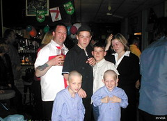 a Young Family from Walthamstow  in The East End of London ' England .. 2002. (mrvisk) Tags: mother father twin boys sons pic man woman mrvisk drink tattoo smiles groupshot english patriots 21st century british people blonde birthday party balloons indoor mature