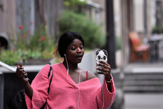 Talking with... panda! (Franck gallery) Tags: paris streetphoto streetsofparis youngwoman funny phone color people
