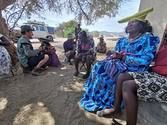 Kas filming some of the women after the community meeting, Puros