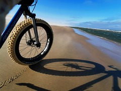 Cycling along the beach into a strong headwind
