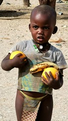 Young boy with the fruit we gave him, Puros