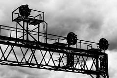 09-2747bw (George Hamlin) Tags: pennsylvania summerhill railroad signal bridge norfolk southern railway ns sky clouds silhouette structural shapes steel photodecor george hamlin photography monochrome black white