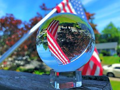 Day 84: captured the flag (Thunderstormnightmare) Tags: photochallenge challenge iphonex iphone still picturechallenge unlimitedphotos grass lakestevens americanflag stripes stars home afternoon day car pole saturday june spring outside outdoor amazing neat clouds mailbox trees green sky blue red white crystalball lensball flag washington