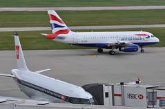 Taxi-out: 'BA952M' (BA0952) LHR-MUC (A380spotter) Tags: departure taxiout apron airbus a319 100 geupd toflytoserve emblem achievement crest coatofarms ba952m ba0952 lhrmuc geupj airbusa319100poweredbyiaev2500engines beabritisheuropeanairways redsquare19591968 britishairways10019192019 centenary retrocolours livery scheme retrojet 2019 ba100 baretrojet internationalconsolidatedairlinesgroupsa iag britishairwaysshuttle sht britishairways baw ba sht8w ba1444 lhredi stand502 502 gatea2 link56 twyb taxiwayb t5a terminal5 terminalfive london heathrow egll lhr