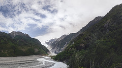 Valley at Franz Josef (bluefantail) Tags: water walkway pentax newzealand pebbles stones river rocks rockformation takumar sky trees outside bush panorama a7s aotearoa sony green hdr landscape valley bluesky national nature glacier franzjosef franzjosefglacier waterfall ice frozen mountains forest