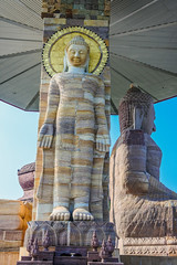 Wat Putthanimit, Wat Phu Khao , Kalasin, Thailand (www.icon0.com) Tags: old sky sculpture building art history tourism church beautiful statue stone architecture asian thailand religious gold golden big ancient worship asia day quiet peace bright image buddha background traditional religion style peaceful buddhism landmark tourist thai wat nimit kalasin phuttha travel face temple pagoda outdoor culture calm attraction khao phu