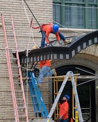 Men at Work (Mondmann) Tags: menatwork workers construction constructionworkers laborers labor building washingtondc usa unitedstates america mondmann fujifilmxt20 hardhats ladders orange