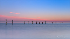 Under a blue sky! (karindebruin) Tags: maasvlakte nederland noordzee northsea thenetherlands zonsondergang zuidholland afzetting hightide hoogwater paaltjes poles sunset water