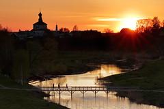 Sunset over Suzdal - Russia (johnnyfox712) Tags: sunset suzdal river goldenhour goldenring bridge pedestrian russia church orthodoxchurch orthodox spring orange yellow crossing pedestriancrossing landscape travelphotography