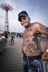 Tattooed man, Coney Island (vhines200) Tags: newyork brooklyn coneyisland 2019 leica parachutedrop tattoos man portrait