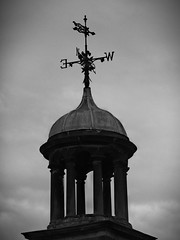 Weather Vane on the Clocktower at the old Coachhouse Roundhay (oneofmanybills) Tags: clocktower weathervane roundhay coachhouse leeds blackandwhote bw olympus clouds
