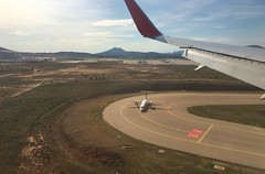 touching down in Athens, Greece - from Air Canada Rouge B767-300 (jeffglobalwanderer) Tags: athens greece athensinternationalairport ath aerialphoto viewfromaircraft airportrunway taxiway aircanadarouge b767300 windowseat