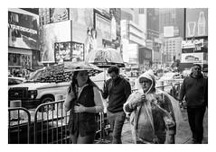 FILM - Times Square umbrellas (fishyfish_arcade) Tags: 35mm analogphotography bw blackwhite blackandwhite canonsureshotz135 filmphotography filmisnotdead hp5 istillshootfilm monochrome newyork analogcamera compact film ilford mono streetphotography umbrella rain