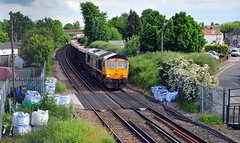 66767 heads through Slade Green and past the location where there was a level crossing and signal box known as Northend sidings, on the 6Y58 15.52 Tonbridge West Yard to Angerstein Wharf on 28-5-19. Copyright Ian Cuthbertson (I C railway photo's) Tags: class66 66767 gbrf sladegreen 6y58