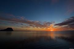 IMGP6280 Sunset looking Le Morne (Claudio e Lucia Images around the world) Tags: sunset reflections sun sky clouds lemorne mountain ocean orange mauritius pentax pentaxk3ii pentaxcamera pentaxart sigma sigma1020 sigmalens sigmaart