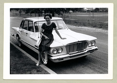 """1962 Plymouth Valiant (Vintage Cars & People) Tags: vintage us usa america vintageusa classic black white """"blackwhite"""" sw photo foto photography automobile car cars motor vehicle antique auto woman lady dress handbag shoes heels peeptoes necklace plymouth valiant 1960s 60s sixties merrygoround swings rowofswings suburbia suburbs playground"""