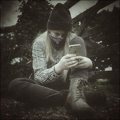 Teenager with iPhone (Lycia Moore) Tags: country girl rural people person family outside portrait old atmospheric