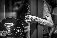 coffee inside and smoke outside (Gerrit-Jan Visser) Tags: geimporteerd streetphotography amsterdam smoke joint coffee choice bnw blackandwhite mcdonalds