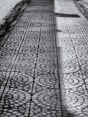 Tile patterns (cizauskas) Tags: shadow georgia tile pattern eastatlanta eav blackandwhite monochrome canon manualfocus canonfd fotodiox legacylens alley streetscene