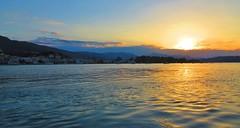 sunset calm - Poros Island, Greece (jeffglobalwanderer) Tags: poros porostown porosisland greece greekislands europe europeantravel water saronicgulf aegeansea sunset sunsetglow orangesky reflection