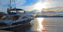 catching the sunset rays - Poros Island, Greece (jeffglobalwanderer) Tags: sunset sunsetglow yacht boat marina harbor reflection sea water clouds porosisland greece greekislands europe