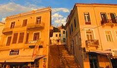 sunset light baths the town - Poros Island, Greece (jeffglobalwanderer) Tags: sunset sunsetglow eveninglight town porostown poros island greekislands saronicislands greece europe