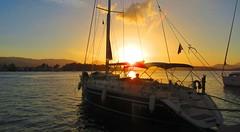 Poros Island, Greece - chilling at sunset (jeffglobalwanderer) Tags: sunset sunsetglow yacht yachtcharter harbor marina islandofporos poros greece greekisland europeantravel europe water aegeansea
