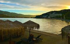 Askeli Beach sunset - Poros Island, Greece (jeffglobalwanderer) Tags: sunset sunsetglow reflection askelibeach beach beachumrellas beachclub water aegeansea greekisland greece europe beachresort poros island
