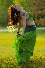 Gypsy Queen (Fly Sandman) Tags: model modelshoot gypsy bellydancer existinglight naturallight sony a99 alpha backlight zorinskylakepark omaha nebraska woman green goldenhour magichour tattoo triforce feathers redhead