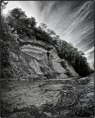 Zoar Valley Sunburst (Edward Bartel) Tags: valley zoar m43ftw landscape hike water river monochrome toned silvertone rays silverefex clouds sunburst riverbed gowanda ny usa
