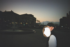 (michaelimages) Tags: film disposable camera 35mm dusk sunset sun night nighttime portrait madison wisconsin midwest fountain water old building burn burnt hole lifestyle