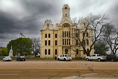 Hill County Courthouse (wyojones) Tags: street trees sky building cars grass statue clouds fire texas afternoon cloudy flag flags architect policecar restoration courthouse hillsboro corinthiancolumns italianate influences hillcounty woodframed classicalrevival hillcountycourthouse secondempirestyle wcdodson highclocktower mansardrooftreatment courthousesquare nationalregisterofhistoricplaces