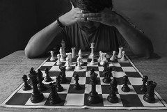 A game of white and black. (Bhuvan N) Tags: chess chessplayer blackandwhite mono monochrome bnwportrait portraits selfportrait selfie lowkey male chessset thinking people bw portrait bnw absoluteblackandwhite play game hands flickrfriday remembrance