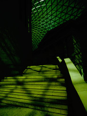 Climbing High in the British Museum (Steve Taylor (Photography)) Tags: britishmuseum architecture museum steps stairs roof black green contrast stark glass metal stone uk gb england greatbritain unitedkingdom london shadow silhouette autumn sunny sunshine