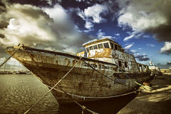 Old boat (Pawel Wietecha) Tags: old boat color colors light travel trip journey port sea water outdoor ship trapani italy sicilia island blue orange yellow sky clouds sunset harbor seaport sicily