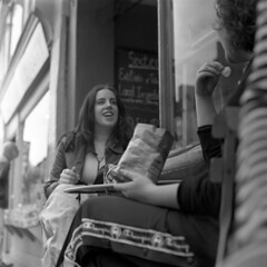 Connected (4foot2) Tags: streetphoto street streetphotography candid candidportrate reportage reportagephotography people peoplewatching peopleofbrighton interestingpeople northlaines laines brighton analogue film filmphotography 120film mediumformat blackandwhite bw mono monochrome shootfromtheknee zonefocus guess eat eating food kiev kiev88cm 88cm киев88cm ukrainiancamera carl carlzeissjena carlzeissjenabiometar80mm28 zeiss biometar80mm28 biometar 80mm f28 28 ilfordhp5plus ilford standdevelop rodinal 2019 fourfoottwo 4foot2 4foot2flickr 4foot2photostream