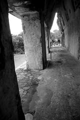 Corbelled Arch (peterkelly) Tags: digital canon 6d bw northamerica mexico gadventures mayandiscovery chiapas palenque palenquenationalpark lakamha mayan maya palace corbelledarch stone pillar column people group ruins