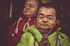 prayer wheel attendants (andy_8357) Tags: boudhanath stupa prayer wheel buddhist mala rosary man bright jacket nepal kathmandu boudha sigma 60mm f28 art dn sony emount a6000 ilce6000 ilcenex alpha mirrorless tibetan buddhism portrait portraiture street jharung khashor